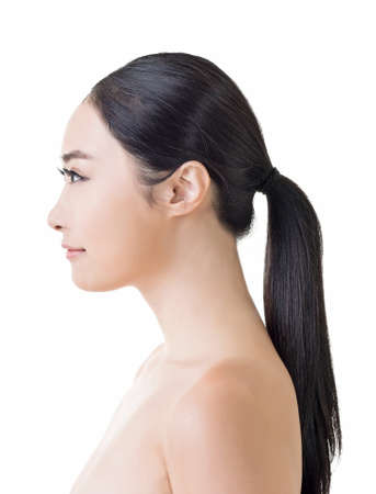 looking to side: Asian beauty face, side view closeup portrait with clean and fresh elegant lady. Stock Photo