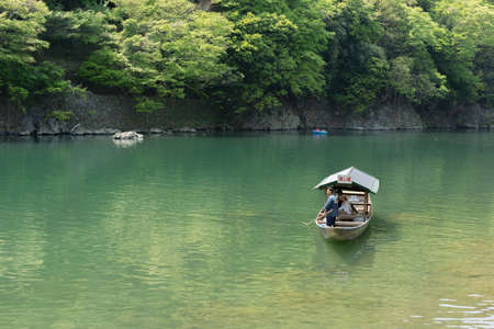 aisa: KYOTO, JAPAN - APRIL 26th  : The ferry of  Hozu(Katsuragawa) River in Arashiyama in Kyoto, Japan on 26th April 2014.