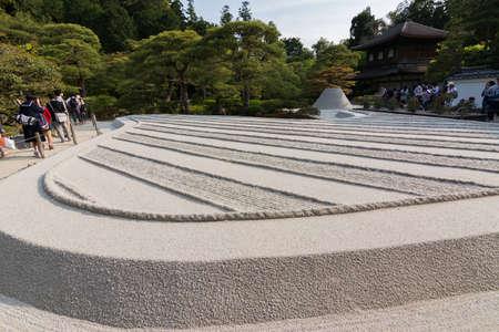 karesansui: KYOTO, JAPAN - APRIL 26th : With white sand landscape in Karesansui of Japanese garden in Ginkakuji Temple, Kyoto, Japan on 26th April 2014. Editorial