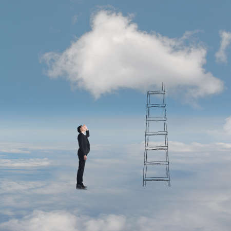 Concept of access to clouds with man and a stair. photo