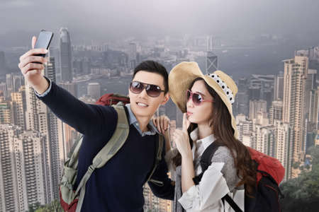 Asian couple travel and selfie in Hong Kong, Asia. photo
