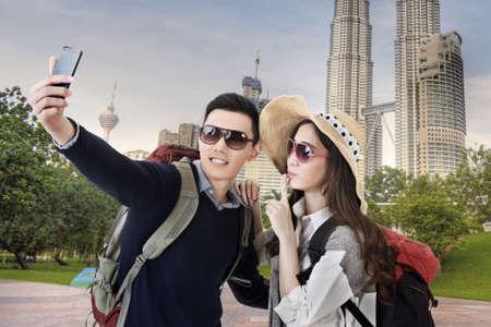 malaysia city: Asian couple travel and selfie in Kuala Lumpur, Malaysia.