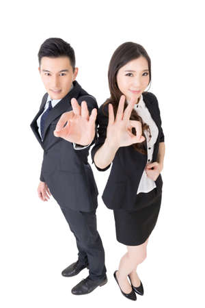 asia women: Attractive Asian business woman and man give you an okay sign, full length portrait isolated on white. Stock Photo