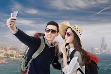 Asian couple travel and selfie in Kaohsiung, Taiwan, Asia. photo