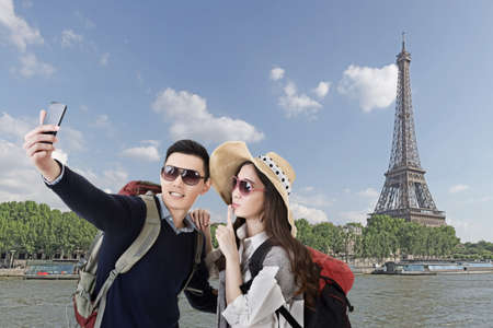 Asian couple travel and selfie in Paris, France. photo