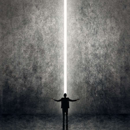Asian business man facing the light, concept of freedom, relax, future, successful etc. photo