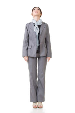 Asian business woman looking up, isolated on white background.