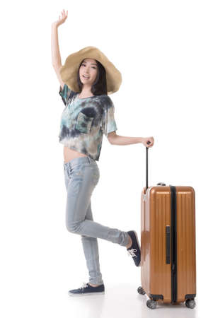 Exciting Asian woman drag a luggage, full length portrait isolated on white background. Stock fotó