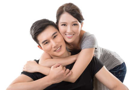 Attractive young Asian couple, closeup portrait on white.