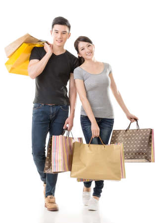 east asian: Asian couple shopping, full length portrait isolated on white background.