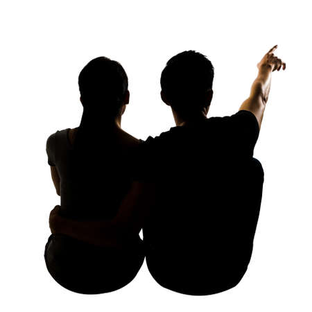 Silhouette of couple sit on ground point faraway, full length portrait isolated on white.