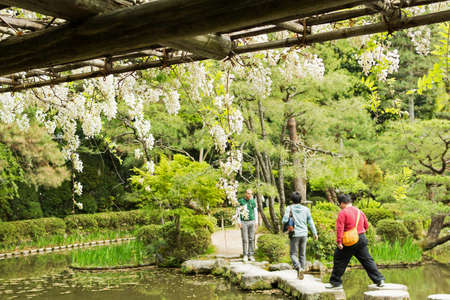 meditaion: KYOTO, JAPAN - APRIL 19th : Some people walk in the zen stone path in a Japanese garden near Heian Shrine, Kyoto,  Japan. on 19th April 2014.