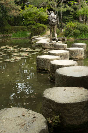 meditaion: KYOTO, JAPAN - APRIL 19th : Someone walk in the zen stone path in a Japanese garden near Heian Shrine, Kyoto,  Japan. on 19th April 2014. Editorial