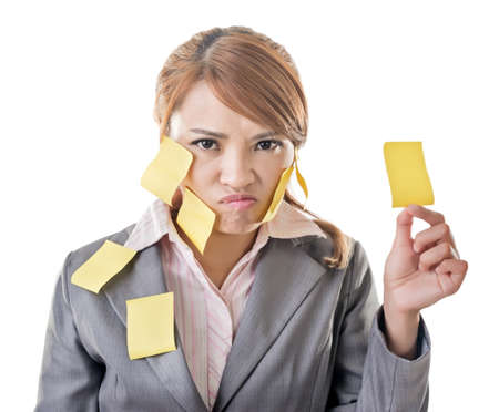 Business woman with many yellow memo note on her body, closeup portrait. photo