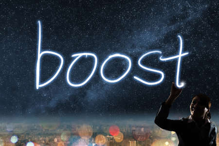 Concept of boost, silhouette asian business woman light drawing. photo