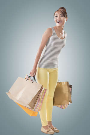 Shopping girl of Asian, full length portrait isolated on white with clipping path. photo