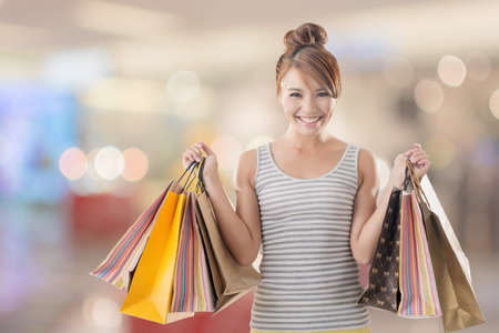 Shopping girl of Asian, closeup portrait isolated on white with clipping path. photo