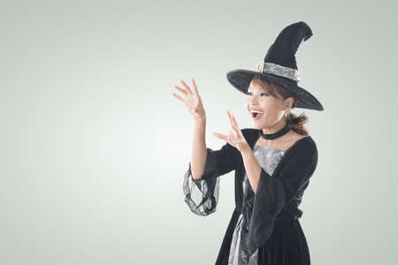 Asian witch woman using magic, closeup portrait with copyspace. photo