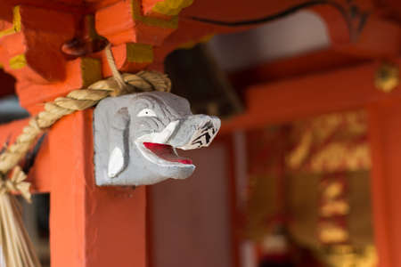 colum: Gray elephant head statue on the  stigmatic of colum in Fushimi Inari Taisha Shrin. Editorial