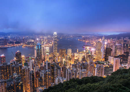 Hong Kong city night with building skyline and skyscraper in Hong Kong. photo