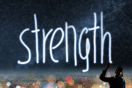 creative strength: Concept of strength, silhouette asian business woman light drawing.