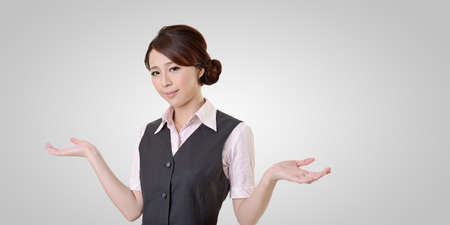 shrugs: Helpless young business woman shrugs her shoulders. closeup portrait with clipping path.