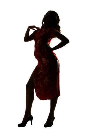 body silhouette: Silhouette of Chinese woman dress traditional cheongsam at New Year, studio shot isolated on white background.