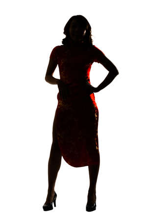 Silhouette of Chinese woman dress traditional cheongsam at New Year, studio shot isolated on white background. photo