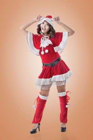 mrs claus: Attractive Christmas lady of Asian woman, full length portrait. Stock Photo