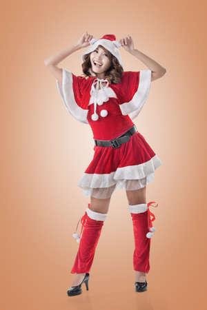 dona: Señora atractiva de la Navidad de la mujer asiática, retrato de cuerpo entero.