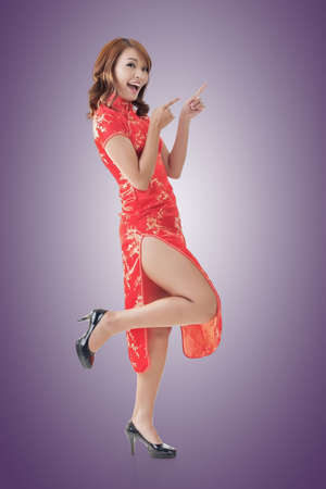 Chinese woman dress traditional cheongsam at New Year and introducing, full length portrait isolated. photo