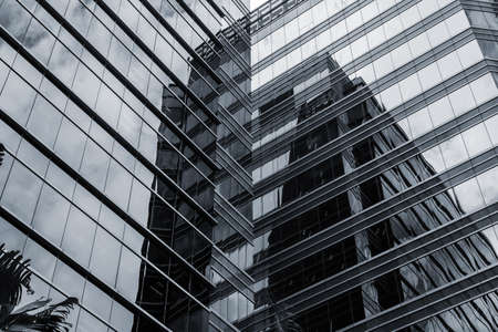corporate buildings: Office glass windows with beautiful reflection in Hong Kong, Asia. Editorial