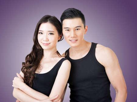 Young Asian sport couple, closeup portrait. photo