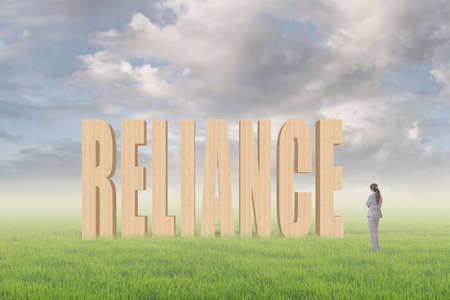 reliance: Concept of credit, reliance, promise etc with 3d text under sky on the outdoor grassland and one Asian business woman thinking about it.