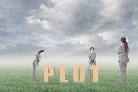 Concept of strategy, plan, idea etc with 3d wooden text and businesswoman under copyspace sky. The Asian woman is the same one. photo
