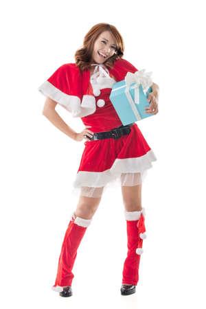 Smile happy Asian Christmas girl hold gift box, isolated full length portrait. photo