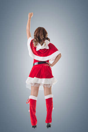 mrs santa claus: Christmas woman relax, rear view, isolated. Stock Photo