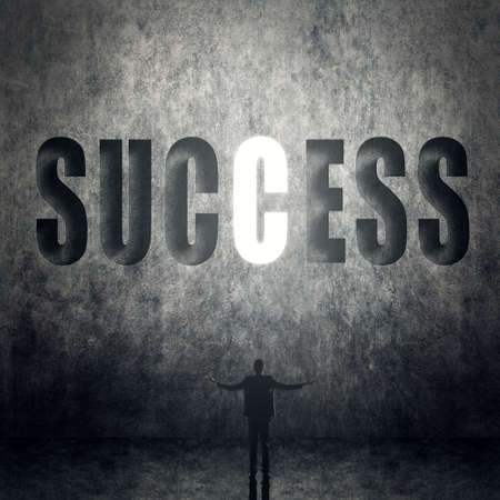 success man: Concept of success, man stand on wall with text.