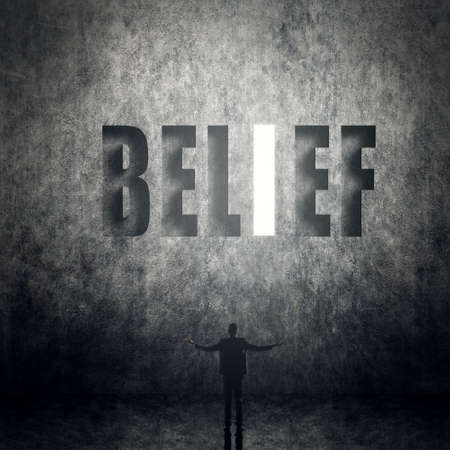 Concept of trust, belief, credit etc, man stand on wall with text. Stock Photo