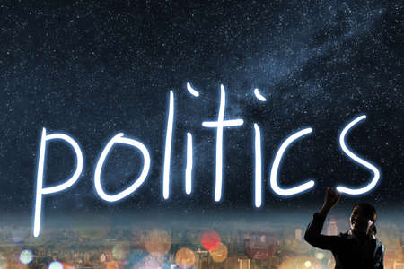 election night: Concept of vote, election, democracy,  silhouette of asian business woman light drawing. Stock Photo
