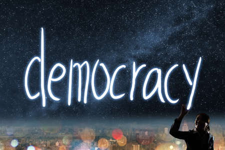 democracy: Concept of vote, election, democracy,  silhouette of asian business woman light drawing. Stock Photo