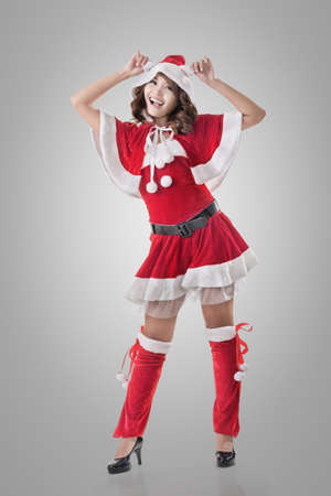Attractive Christmas lady of Asian woman, full length portrait. Stock Photo