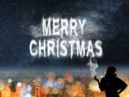 cigar label: Christmas concept of lady with smoke text in the city night. Stock Photo