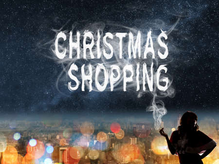 city by night: Christmas concept of  shopping to buy with Asian lady and smoke text in the city night. Stock Photo