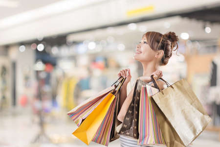 asian girl shopping: Shopping girl of Asian, closeup portrait isolated on white with clipping path. Stock Photo