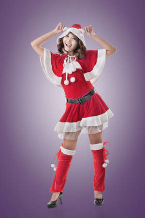 mrs santa claus: Attractive Christmas lady of Asian woman, full length portrait. Stock Photo