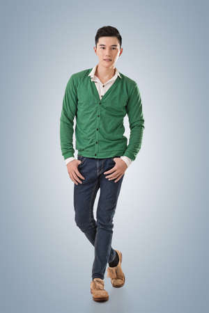 korean man: Handsome young Asian man with sweater, full length portrait isolated.