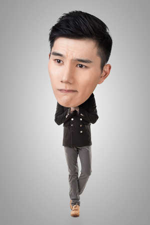 big head: Funny Asian big head man, full length portrait.