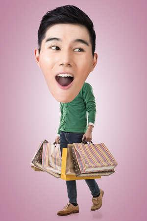 full length portrait: Funny shopping Asian guy, full length portrait. Stock Photo