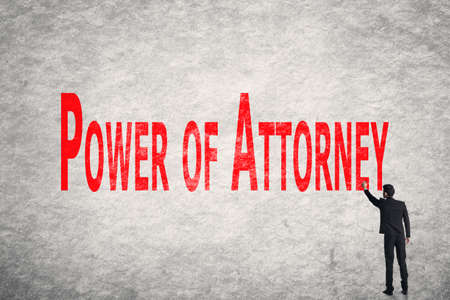 patents: Asian business man write words on wall, Power Of Attorney Stock Photo